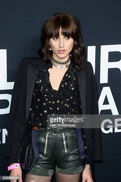 Artist Langley Fox in Saint Laurent by Hedi Slimane arrives at the Saint Laurent show at the Hollywood Palladium on February 10 2016 in Los Angeles...