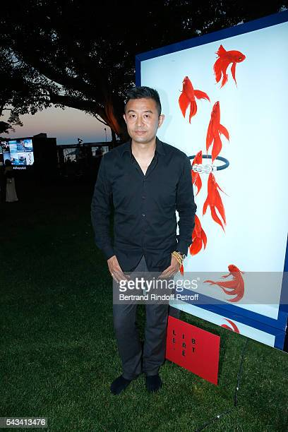 Artist Liu Bolin poses in front of his work during Fred Jeweler Celebrates 80 Years of Creation at Hotel Cap Estel in Eze France on June 23 2016