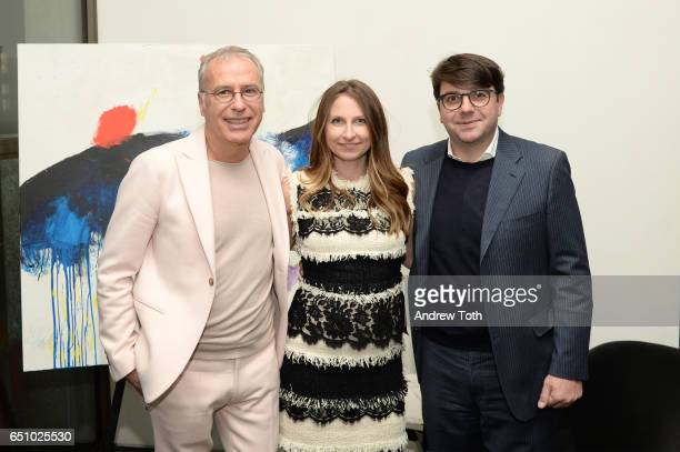 Artist Lorenzo Marini Laura Anzani Managing Director Poliform USA and Luca Bizi Director of Sales Poliform USA attend the Lorenzo Marini Art Opening...
