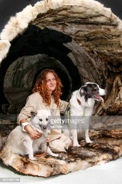 Artist Maja Smrekar and her dogs sit in her wolf coat tunnel 'K9_topology ECCE CANIS' during the 'Ars Electronica' Group Exhibition and 'Dritte...