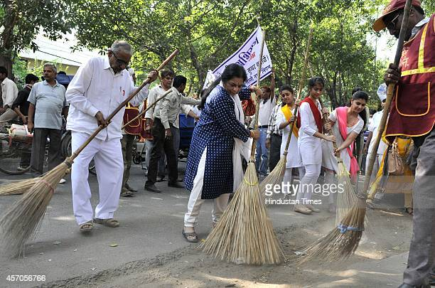 Artist Manya Malhotra and Kathak Dancer Uma Sharma participate in the Swachh Bharat Abhiyan at East of Kailash on October 11 2014 in New Delhi India...