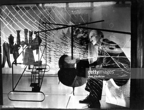 Artist Marcel Duchamp being viewed through glass of his major work The Bride Stripped Bare by Her Bachelors''