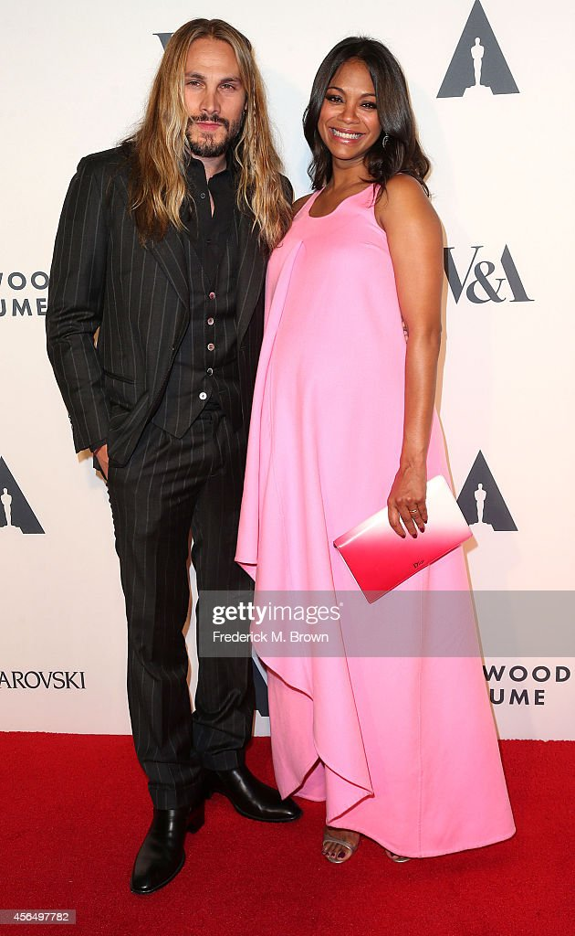 Artist Marco Perego (L) and actress Zoe Saldana attend The Academy of Motion Picture Arts and Sciences' Hollywood Costume Opening Party at the Wilshire May Company Building on October 1, 2014 in Los Angeles, California.