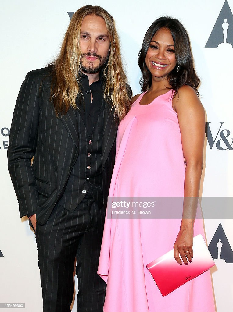 Artist <a gi-track='captionPersonalityLinkClicked' href=/galleries/search?phrase=Marco+Perego&family=editorial&specificpeople=3061782 ng-click='$event.stopPropagation()'>Marco Perego</a> (L) and actress <a gi-track='captionPersonalityLinkClicked' href=/galleries/search?phrase=Zoe+Saldana&family=editorial&specificpeople=542691 ng-click='$event.stopPropagation()'>Zoe Saldana</a> attend The Academy of Motion Picture Arts and Sciences' Hollywood Costume Opening Party at the Wilshire May Company Building on October 1, 2014 in Los Angeles, California.