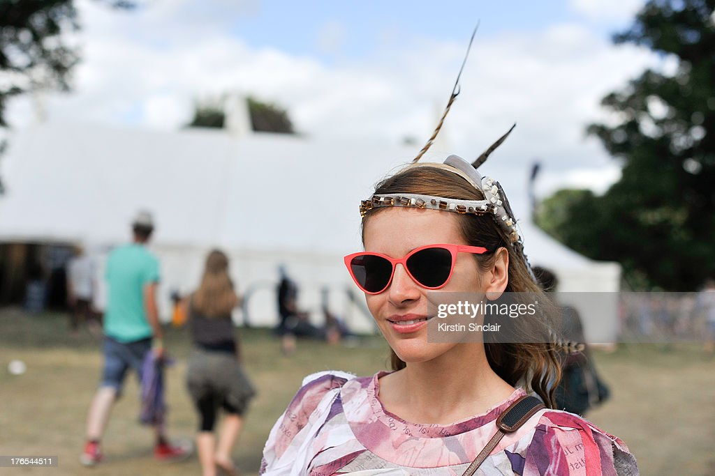 Artist Margot Trushina wears a Mozami Ishiguro dress, Ilalia Rideper sunglasses and a Sara Tiara head dress on day 4 of Wilderness Festival on August 11, 2013 in Cornbury Park, Oxfordshire, England.