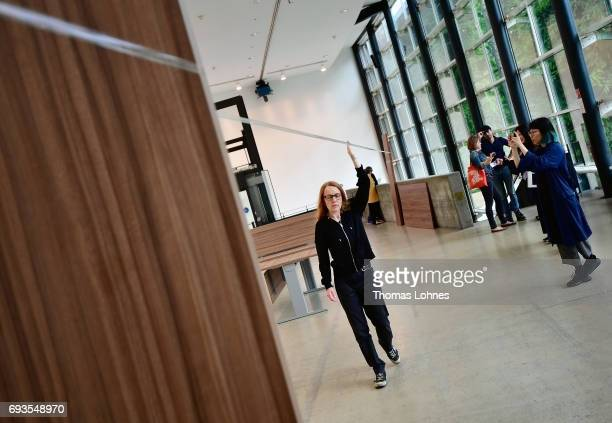 Artist Marie Cool performs with scotch tape in her installation 'Untitled' on June 7 2017 in Kassel Germany The documenta 14 is the fourteenth...