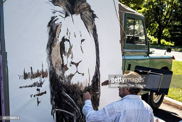 Artist Mark Balma paints a huge mural of Cecil in Dr Walter Palmer's parking lot on July 29 2015 at River Bluff Dental in Bloomington Minn Bala went...