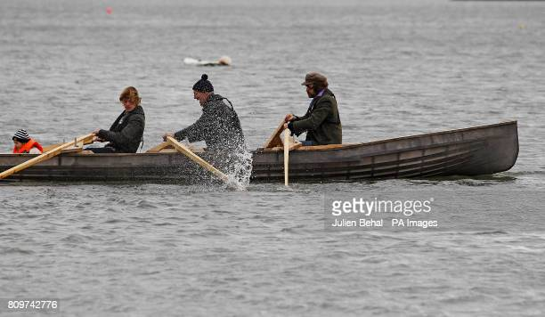 Artist Mark Redden and friends including singer Liam O Maonlai on the inaugural row of the traditional Irish currach at the launch of the two boats...