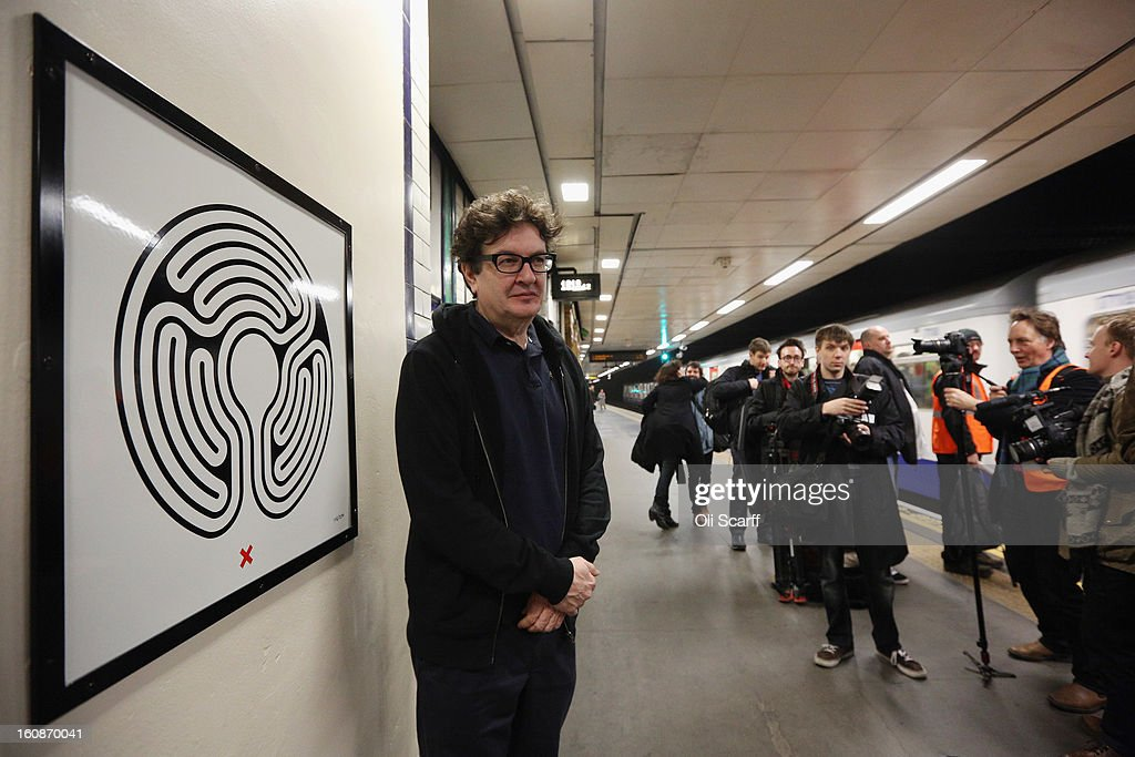 Artist Mark Wallinger (L) unveils his artwork on the platform of St James's Park Station as part of London Underground's largest ever art commission on February 7, 2013 in London, England. Mr Wallinger has been commissioned to produce artworks in all 270 stations on the Underground network to celebrate the 150 year anniversary of the tube opening.