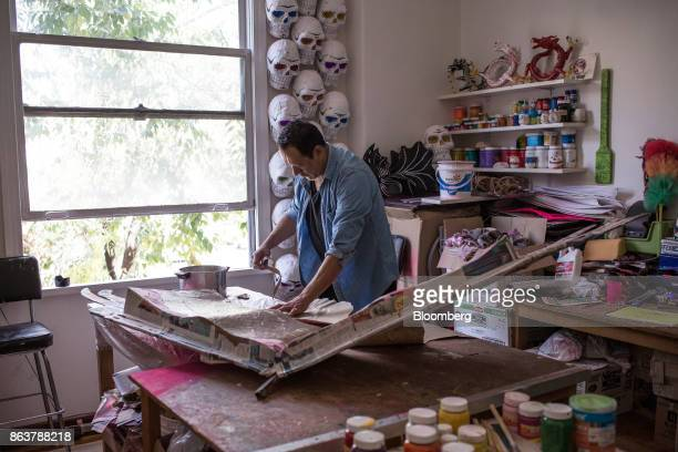 Artist Mauricio Mercado uses paper and art paste to create a giant alebrije Mexican folk art sculpture at the Mauricio Mercado y Compaia collective...