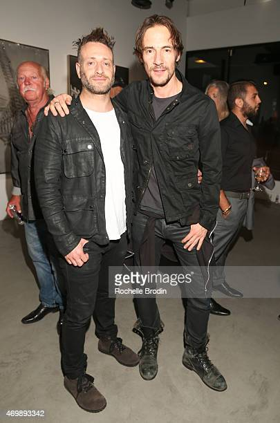 Artist Michael Sagato and art director/judge Thomas Hayo attend 'The Folly of Youth' exhibition at De Re Gallery on April 15 2015 in West Hollywood...