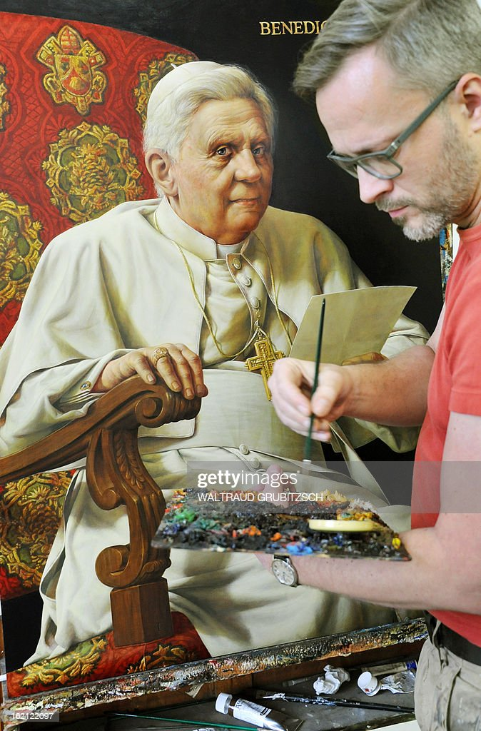 Artist Michael Triegel (R) works on his second portrait painting of outgoing Pope Benedict XVI in his workshop in Leipzig, eastern Germany on February 19, 2013. The painting measuring 1m by 72 cm was ordered by the German embassy in Vatican City State to be handed to the Holy See as a loan on the Pope's birthday on April 16, 2013.