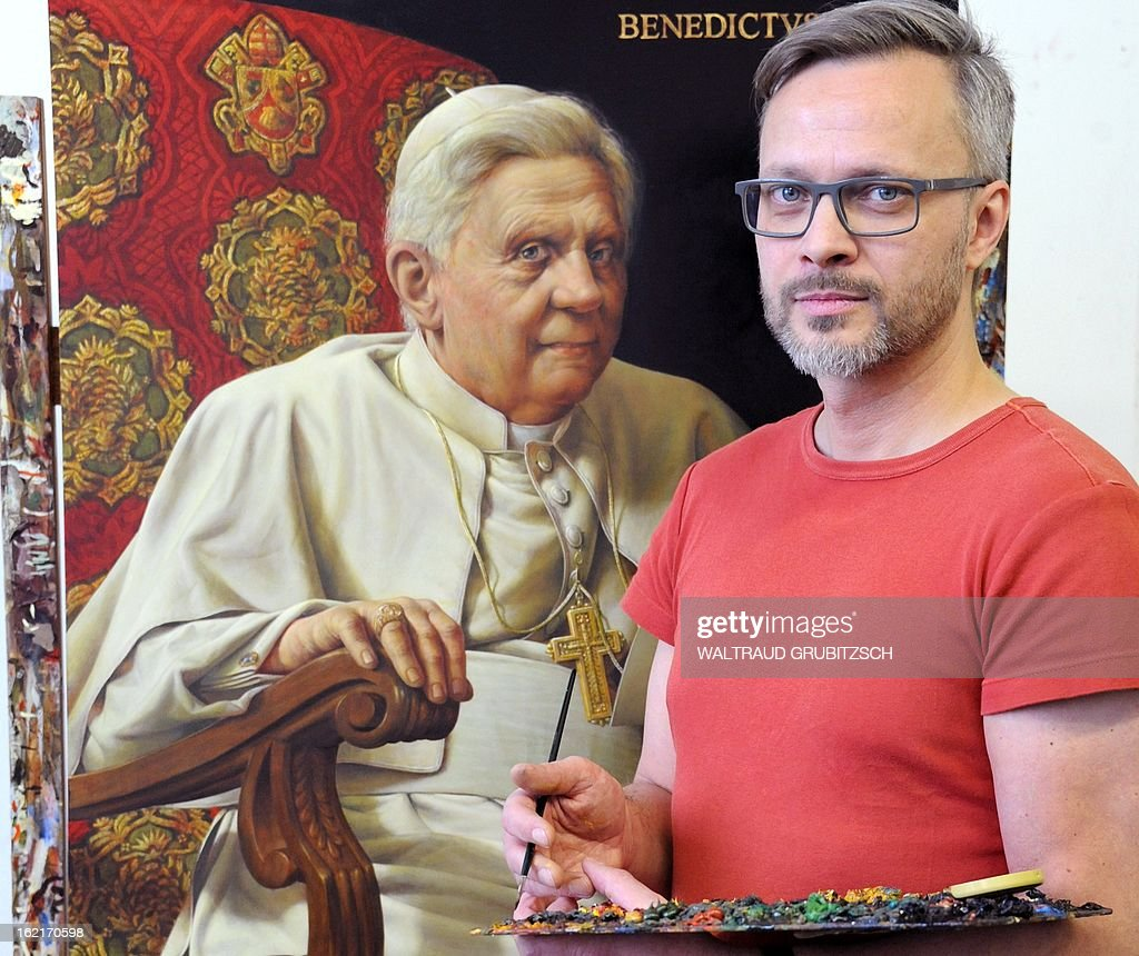 Artist Michael Triegel (R) works on his second portrait painting of outgoing Pope Benedict XVI in his workshop in Leipzig, eastern Germany on February 19, 2013. The painting measuring 1m by 72 cm was ordered by the German embassy in Vatican City State to be handed to the Holy See as a loan on the Pope's birthday on April 16, 2013. AFP PHOTO / WALTRAUD GRUBITZSCH GERMANY OUT