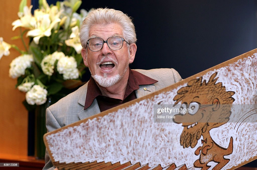 Artist, musician and author <a gi-track='captionPersonalityLinkClicked' href=/galleries/search?phrase=Rolf+Harris&family=editorial&specificpeople=160469 ng-click='$event.stopPropagation()'>Rolf Harris</a> plays the Wobble Board during a literary lunch to promote his latest book 'Tie Me Kangaroo Down Sport' at Star City on November 25, 2008 in Sydney, Australia.