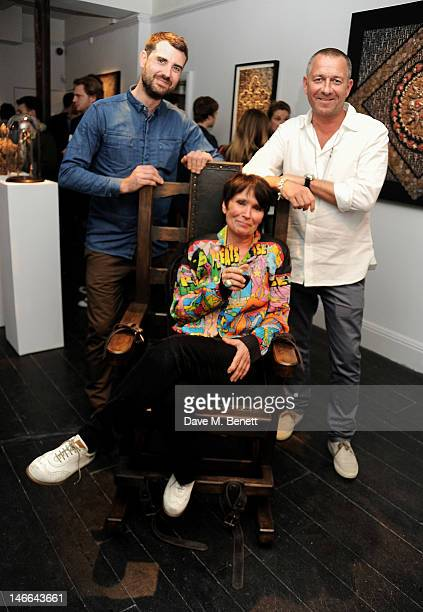 Artist Nancy Fouts poses with gallery owners James Golding and Sean Pertwee attend a private view of 'Artifact A Solo Exhibition By Nancy Fouts' at...