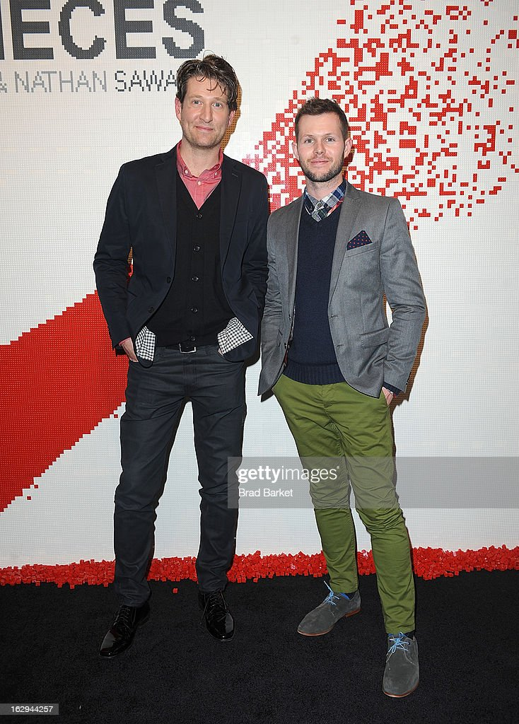 Artist Nathan Sawaya(L) and Dean West attend the In Pieces Exhibition Opening at Openhouse Gallery on March 1, 2013 in New York City.