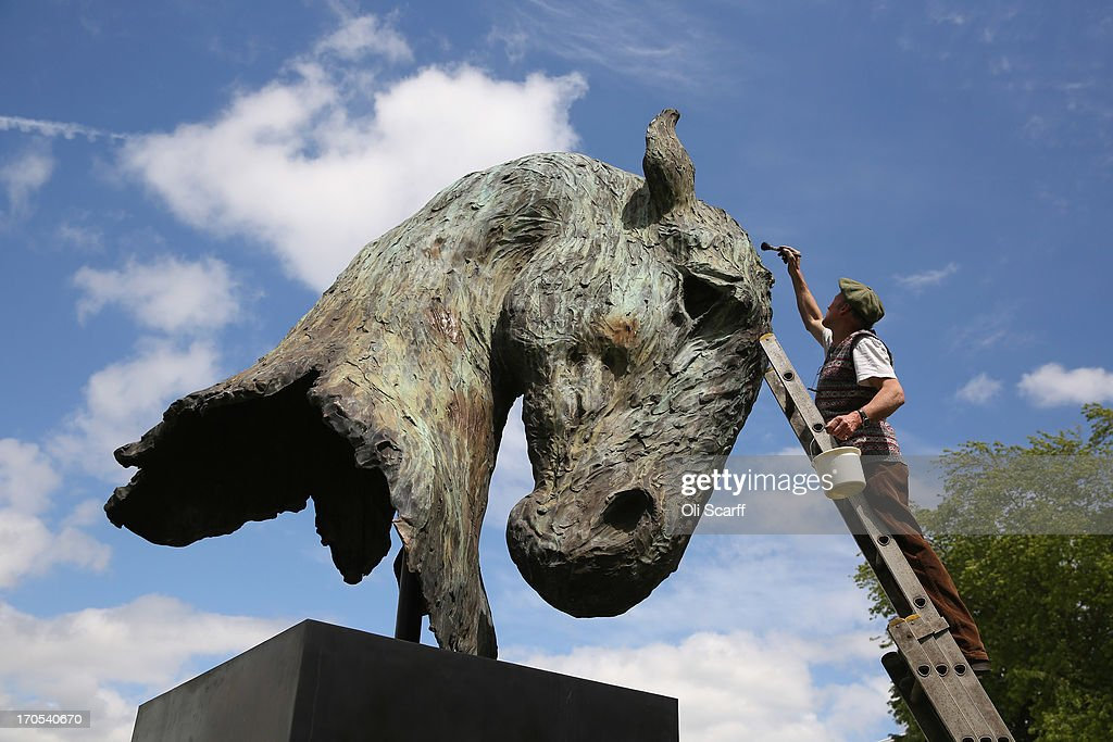 Artist Nic Fiddian-Green puts the finishing touches to his sculpture 'The Mighty Head' as it is installed in the Royal Enclosure at Ascot Racecourse on June 14, 2013 in Ascot, England. The 'Royal Ascot' race meeting will take place at the racecourse from 18 - 22 June, 2013.