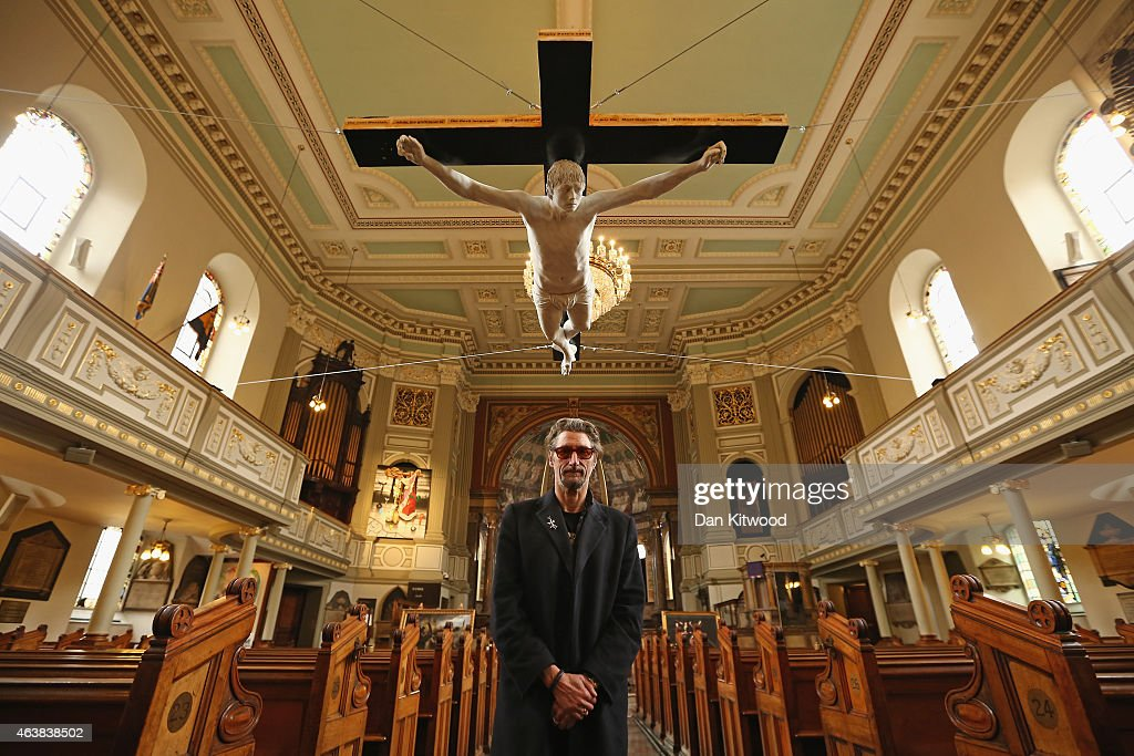 Artist Nick Reynolds poses beneath a Life sized sculpture depicting singer Pete Doherty on a crucifix hanging in St Marylebone Parish Church on February 19, 2015 in London, England. The piece entitled 'For Pete's Sake' is to hang in the 200 year old church as part of the 'Stations of the Cross' exhibition, and is open to the public until March 17, 2015.