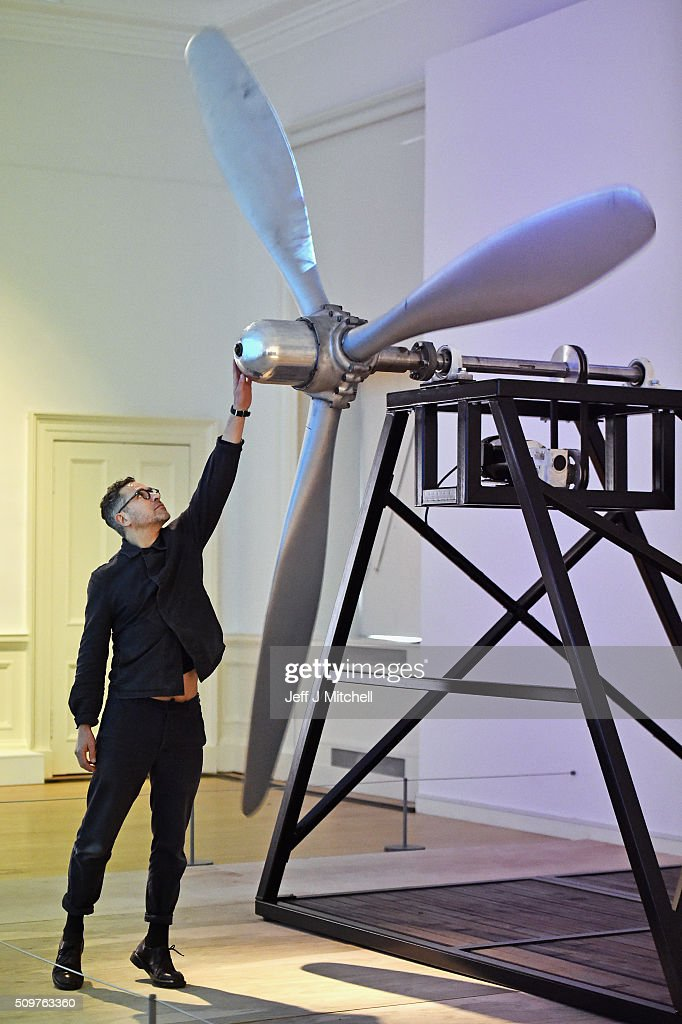 Artist Oliver Chanarin stands beside a propeller from a B-52 bomber, part of an installation at the Scottish National Gallery of Modern Art on February 12, 2016 in Edinburgh, Scotland. Works by twenty two of the artists in British Art Show 8 will be exhibited at the Scottish National Gallery of Modern Art. The selection reflects the huge diversity of media used by artists working today, and features painting, sculpture, printmaking, textiles, film and video, large-scale installation and ceramics. Artists include the 2013 Turner Prize-winner Laure Prouvost, the acclaimed Scottish filmmaker Rachel Maclean, the celebrated artist Linder, who started her career at the centre of the Seventies punk scene in Manchester, and Turner Prize-nominees Lynette Yiadom-Boakye and Ciara Phillips.
