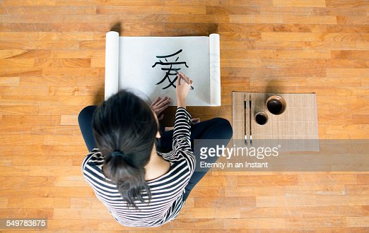 Artist painting chinese calligraphy