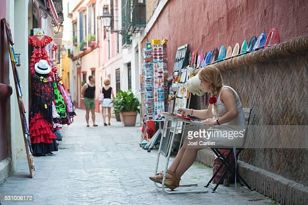 Artist painting in Seville, Spain