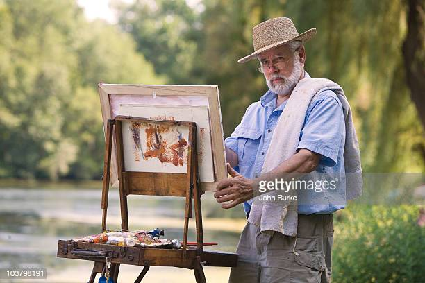 Artist painting outdoors