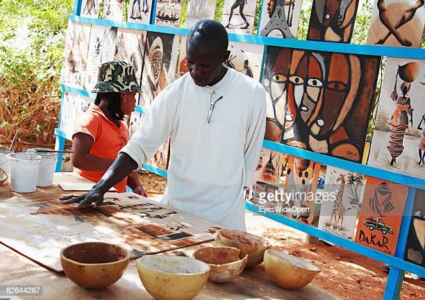 A artist paints on the Ile De Gore on December 27 2007 near Dakar Republic of Senegal The Gore island is situated off the main harbour of Dakar and...