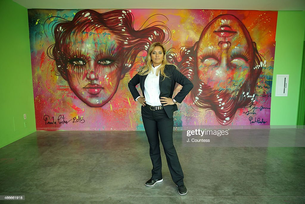 Artist Panmela Castro poses infront of her work on display at Barnard College's 7th Annual Global Symposium at Barnard College on March 13 2015 in...