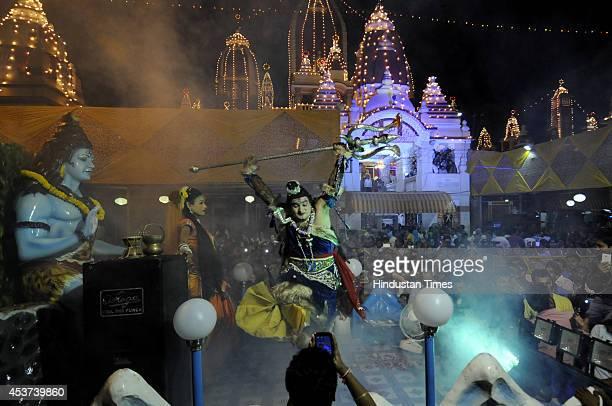 Artist performs as Lord Shiva during Krishna Janmashtami festival celebrations at Birla Mandir on August 17 2014 in New Delhi India Hindu devotees...