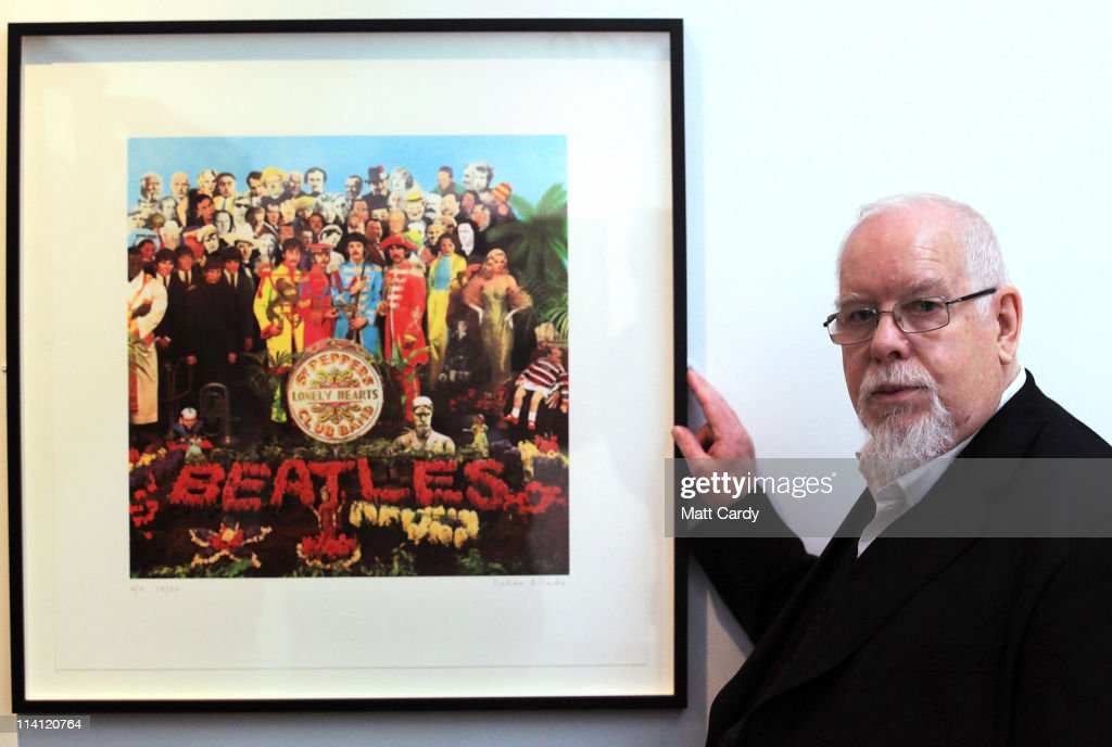 Artist <a gi-track='captionPersonalityLinkClicked' href=/galleries/search?phrase=Peter+Blake&family=editorial&specificpeople=239082 ng-click='$event.stopPropagation()'>Peter Blake</a> poses for a photograph besides a copy of The Beatles Sgt Pepper LP album cover that he designed in 1967 as he reopens the Holburne Museum on May 12, 2011 in Bath, England. The new museum's first exhibition - which opens to the public on Saturday - is <a gi-track='captionPersonalityLinkClicked' href=/galleries/search?phrase=Peter+Blake&family=editorial&specificpeople=239082 ng-click='$event.stopPropagation()'>Peter Blake</a>: A Museum for Myself and will for the first time show extraordinary objects from <a gi-track='captionPersonalityLinkClicked' href=/galleries/search?phrase=Peter+Blake&family=editorial&specificpeople=239082 ng-click='$event.stopPropagation()'>Peter Blake</a>'s own collection together with a number of important works by the artist himself. The new Holburne Museum includes the restoration of its Grade I listed building and the construction of a striking new extension by Eric Parry Architects. The Museum houses a collection of fine and decorative arts built around the remarkable art collection of Sir William Holburne, first assembled in 19th century Bath, including works by Gainsborough, Zoffany and Turner.