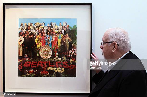 Artist Peter Blake poses for a photograph besides a copy of The Beatles Sgt Pepper LP album cover that he designed in 1967 as he reopens the Holburne...
