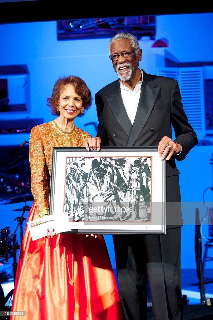Artist Phoebe Beasley and Baskeball Legend Bill Russell pose for a photo at 'An Artful Evening At CAAM' Gala at the California African American Museum on October 12, 2013 in Los Angeles, California.