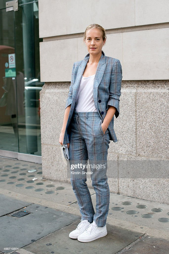 Artist Polly Morgan is wearing Nike trainers, Todds bag, Richard Nichols suit and Topshop top on day 3 of London Collections: Women on September 14, 2014 in London, England.