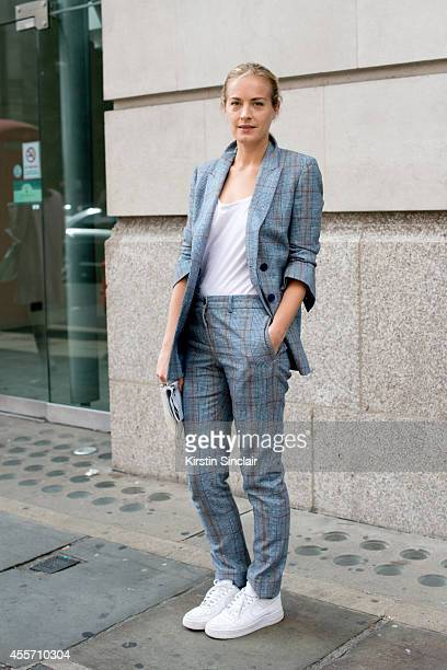 Artist Polly Morgan is wearing Nike trainers Todds bag Richard Nichols suit and Topshop top on day 3 of London Collections Women on September 14 2014...
