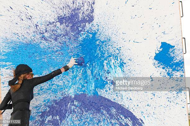 Artist Princess Tarinan von Anhalt works on a piece of art using the wind coming from the engine of Flexjet's Learjet 40 XR engine at Signature...