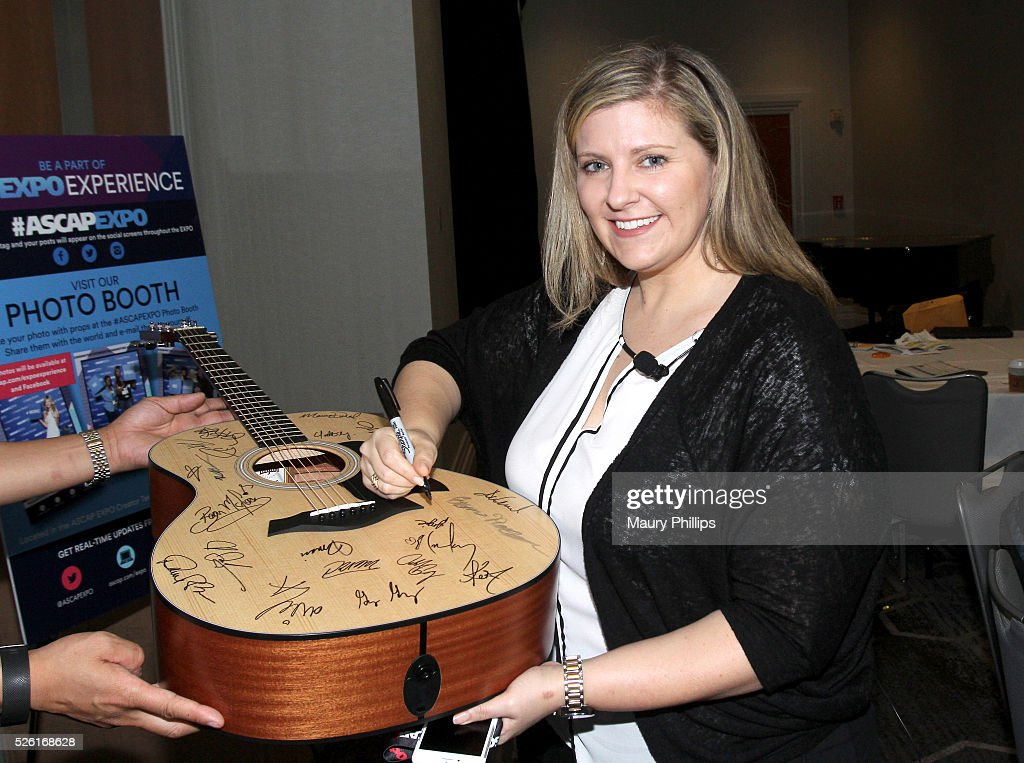 Artist Publishing Group GM Angie Pagano signs a #StandWithSongwriters guitar, which will be presented in May to members of Congress to urge them to support reform of outdated music licensing laws, during the 2016 ASCAP 'I Create Music' EXPO on April 29, 2016 in Los Angeles, California.