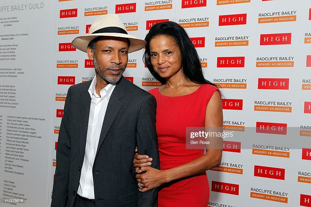 Artist Radcliffe Bailey and his wife actress <a gi-track='captionPersonalityLinkClicked' href=/galleries/search?phrase=Victoria+Rowell&family=editorial&specificpeople=202576 ng-click='$event.stopPropagation()'>Victoria Rowell</a> pose during a private reception for the opening of his exhibition 'Radcliffe Bailey : Memory as Medicine' at High Museum of Art on June 24, 2011 in Atlanta, Georgia.