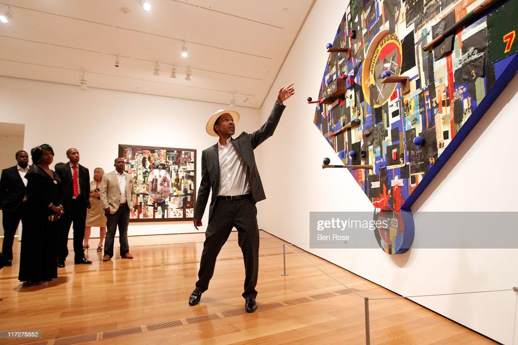 Artist Radcliffe Bailey discusses his work while leading guests on a private tour of the exhibit 'Radcliffe Bailey : Memory as Medicine' at High Museum of Art on June 24, 2011 in Atlanta, Georgia.