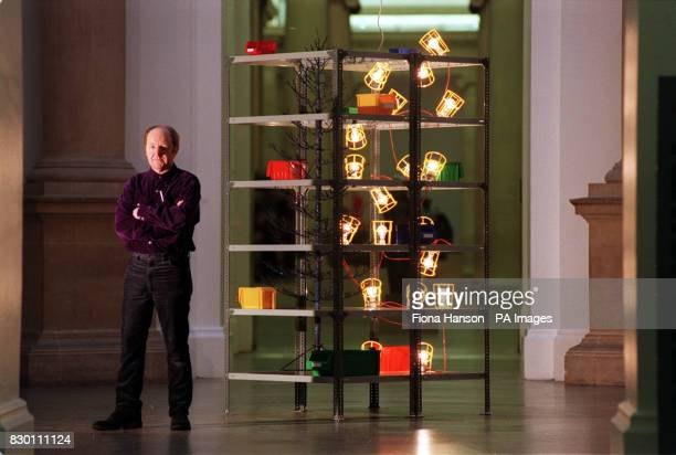 artist Richard Wilson unveils his 'Christmas Tree 1998' which was commissioned by and appears in the Tate Gallery in London The sculpture uses...
