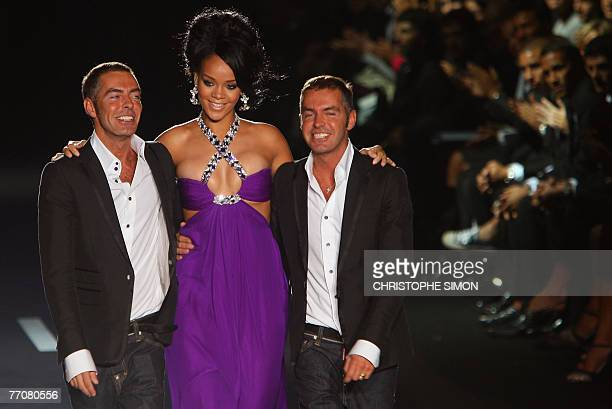 RB artist Rihanna poses with Canadian identicaltwin designers Dean and Dan Caten during fashion house Dsquared2 show of the Milan readytowear fashion...