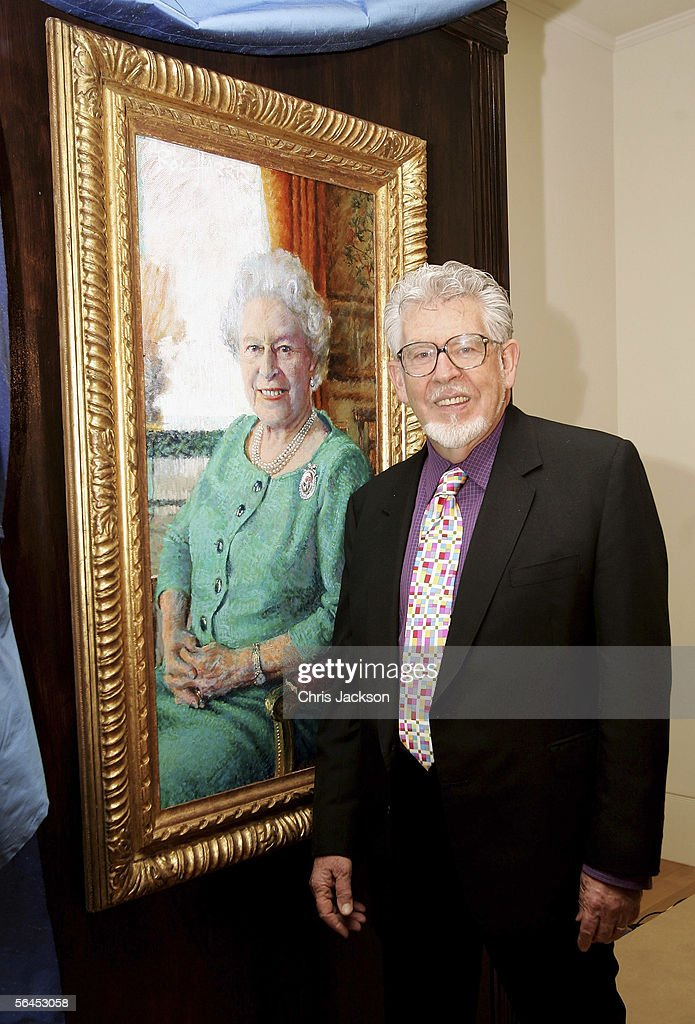 Artist <a gi-track='captionPersonalityLinkClicked' href=/galleries/search?phrase=Rolf+Harris&family=editorial&specificpeople=160469 ng-click='$event.stopPropagation()'>Rolf Harris</a> officially unveils his oil portrait of Queen Elizabeth II at The Queen's Gallery in Buckingham Palace on December 19, 2005 in London, England. Harris was permitted two sittings at Buckingham Palace, which were recorded for a BBC One documentary. More than 120 official portraits have been made of the Queen, by artists ranging from Dame Laura Knight to Lucien Freud.