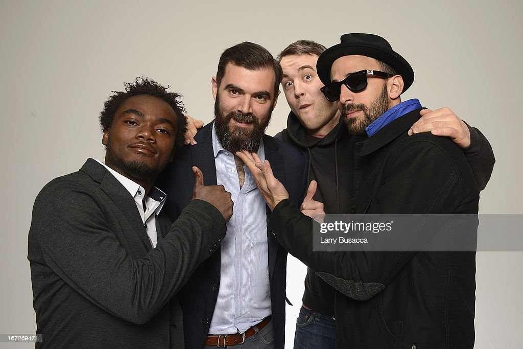 Artist Romel Jean Pierre, producer Emile Abinal, director Alastair Siddons, and artist JR of the film 'Inside Out: The People's Art Project' pose at the Tribeca Film Festival 2013 portrait studio on April 23, 2013 in New York City.