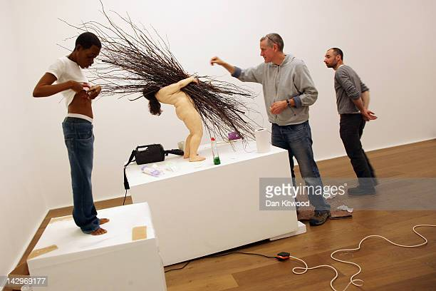 Artist Ron Mueck puts the finishing touches to his piece 'Woman with Sticks' at the Hauser Wirth gallery on April 16 2012 in London England The piece...