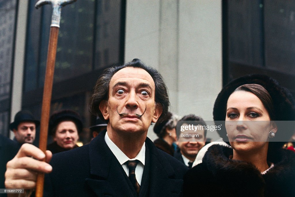 Artist <a gi-track='captionPersonalityLinkClicked' href=/galleries/search?phrase=Salvador+Dali&family=editorial&specificpeople=94477 ng-click='$event.stopPropagation()'>Salvador Dali</a>, lifting his cane, with a woman in New York.