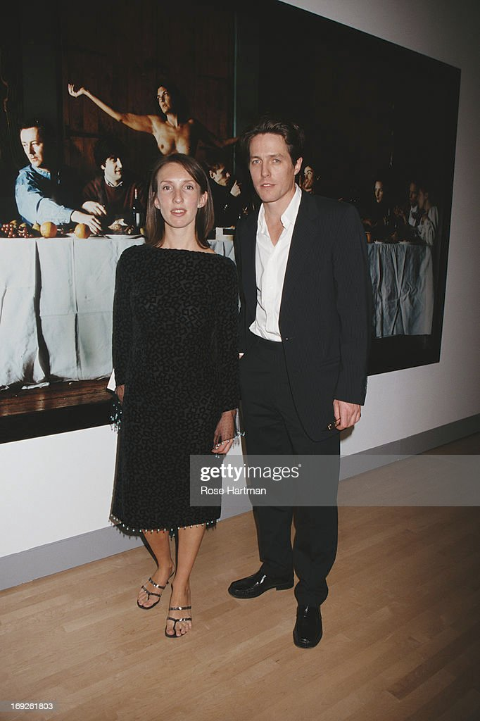 Artist Sam TaylorWood and actor Hugh Grant in front of TaylorWood's 'Wrecked' at the Sensation Benefit and Exhibition Preview at the Brooklyn Museum...