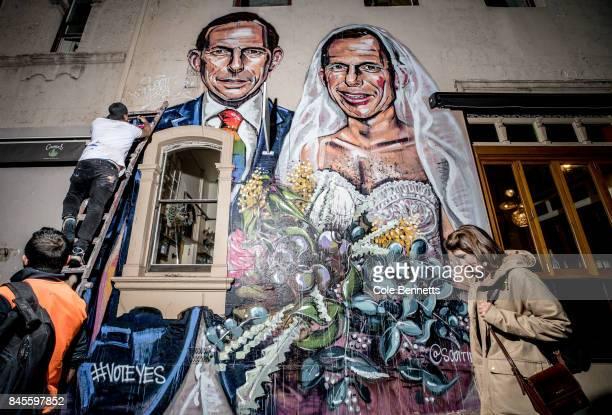 Artist Scott Marsh finishes a mural depicting former Prime Minister Tony Abbott in Redfern on September 11 2017 in Sydney Australia Australians are...
