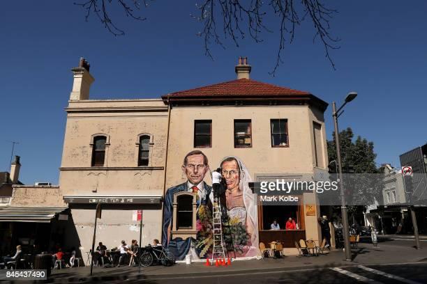 Artist Scott Marsh paints a mural depicting former Prime Minister Tony Abbott in Redfern on September 11 2017 in Sydney Australia Australians are set...