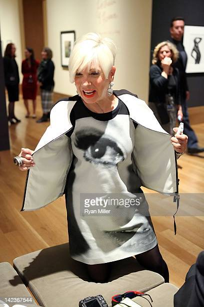 Artist Shari Applebaum poses with her Edie Sedgwick dress during the 'Herb Ritts LA Style' preview and reception to celebrate the opening of the...