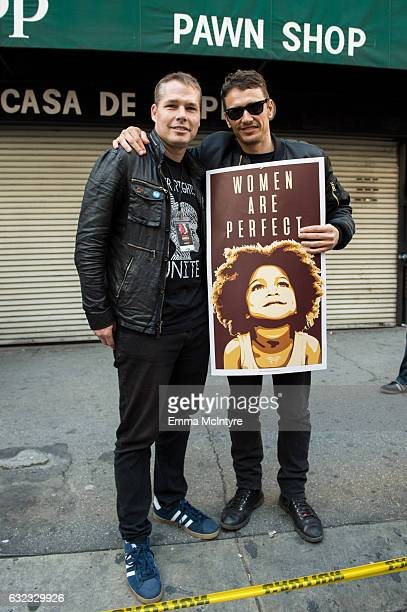 Artist Shepard Fairey and actor James Franco attend the women's march in Los Angeles on January 21 2017 in Los Angeles California