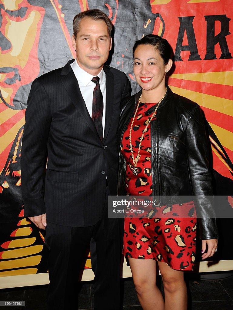 Artist <a gi-track='captionPersonalityLinkClicked' href=/galleries/search?phrase=Shepard+Fairey&family=editorial&specificpeople=2155817 ng-click='$event.stopPropagation()'>Shepard Fairey</a> and wife arrive for the 9th Annual Red Nation Film Festival - Closing Night Gala held at Harmony Gold Theatre on November 14, 2012 in Los Angeles, California.